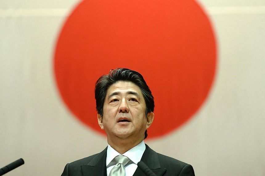 Japanese Prime Minister Shinzo Abe delivers a speech during the graduation ceremony of the National Defense Academy in Yokosuka, Kanagawa Prefecture on March 22, 2014. Japanese Prime Minister Shinzo Abe indicated on Sunday, March 23, 2014, that he wa