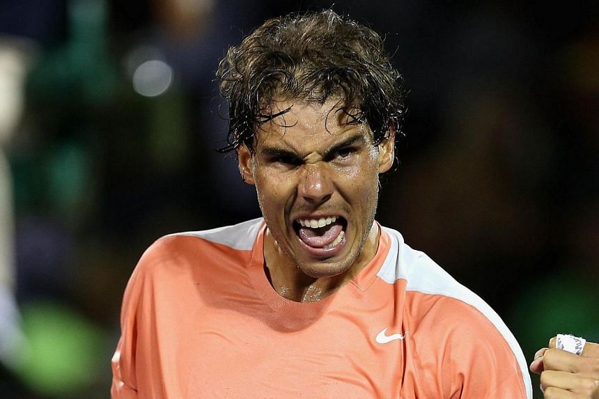 Rafael Nadal of Spain celebrates after his straight sets victory against Lleyton Hewitt of Australia during their second round match during day 6 at the Sony Open at Crandon Park Tennis Center on March 22, 2014 in Key Biscayne, Florida. Tennis world