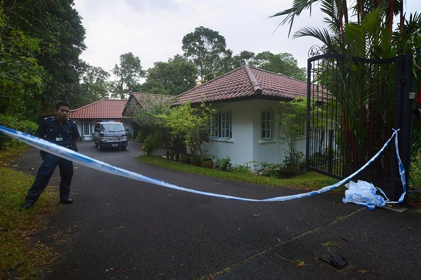 A police line tape at the entrance to porcelain artist Nancy Gan's Bukit Timah bungalow. Ms Nancy Gan - artist, socialite and philanthropist - was cremated on Sunday evening at Mandai Crematorium and Columbarium, after a two-day wake in Mount Vernon