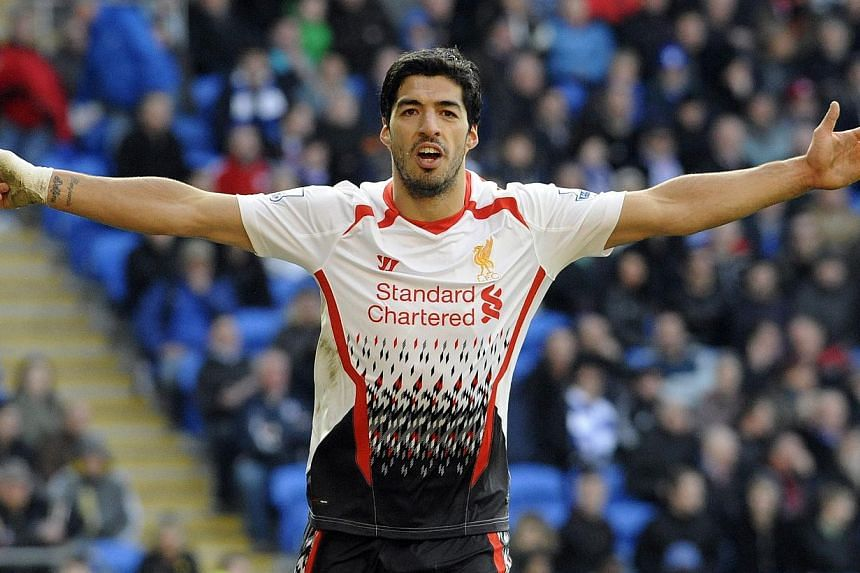 Liverpool's Luis Suarez celebrating his third goal against Cardiff City during their English Premier League match at Cardiff City Stadium in Cardiff on March 22, 2014. -- PHOTO: REUTERS