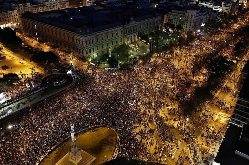 """Anti-austerity protesters crowd into Colon square as they take part in a demonstration which organisers have labeled the """"Marches of Dignity"""" in Madrid, on March 22, 2014. -- PHOTO: REUTERS"""