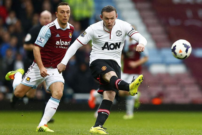 Manchester United's Wayne Rooney scores a goal against West Ham United during their English Premier League soccer match at the Boleyn Ground in London on March 22, 2014. -- PHOTO: REUTERS