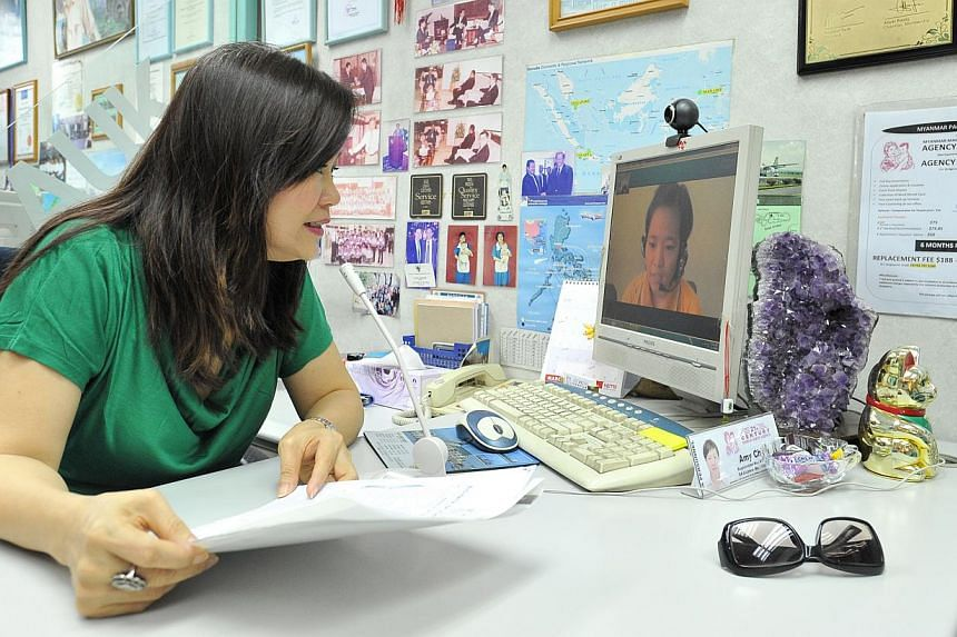 Retiree Dorice Cheong, 58, interviewing potential Myanmar maid Thin Waddy, 23, on Skype at a maid agency. Myanmar maids are the fastest growing group of domestic workers here. -- PHOTO: LIM YAOHUI FOR THE STRAITS TIMES