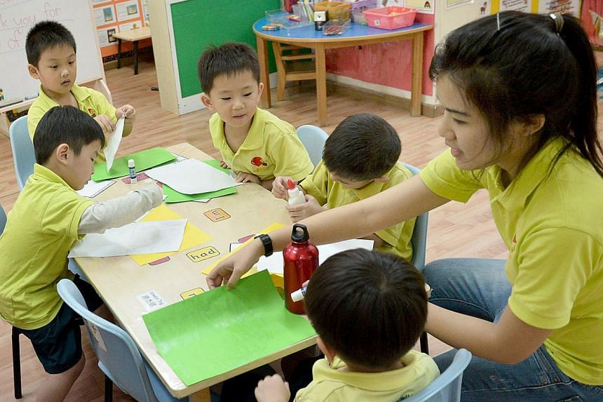 Children at a class in Agape Little Uni pre-school. Staff salaries there have risen by 10 per cent to 20 per cent in the past two years.