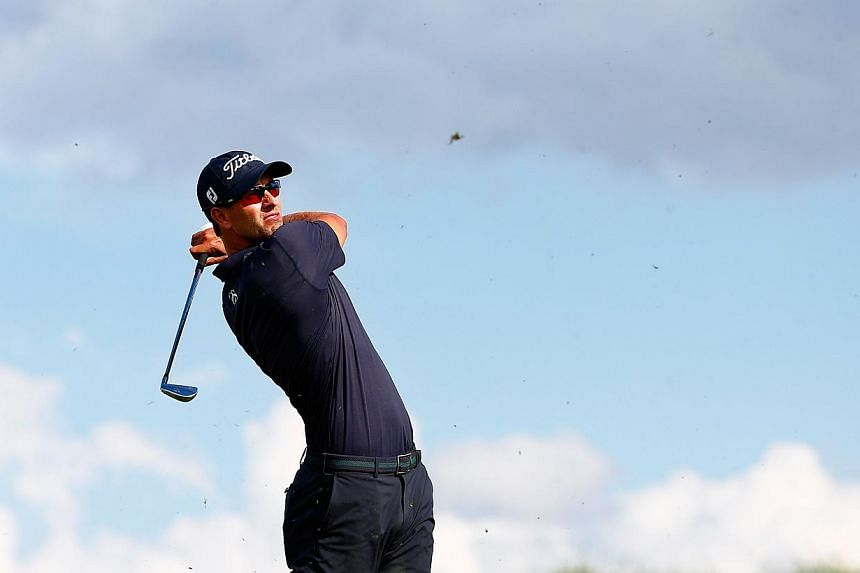 Adam Scott of Australia hits his tee shot on the 14th hole during the final round of the Arnold Palmer Invitational presented by MasterCard at the Bay Hill Club and Lodge in Orlando, Florida, on March 23, 2014. -- PHOTO: AFP