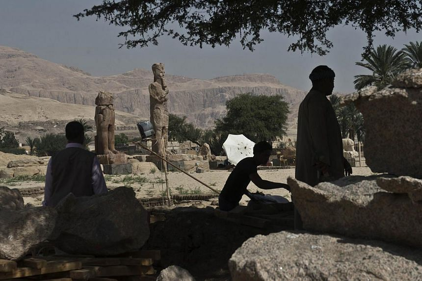 Newly displayed statues of pharaoh Amenhotep III in Egypt's temple city of Luxor on March 23, 2014. -- PHOTO: AFP