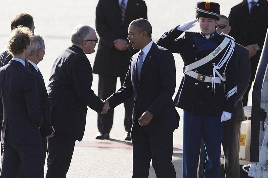 US president Barack Obama (second right) shakes hands with Dutch Foreign Minister Frans Timmermans (third right) after disembarking from Air Force One upon his arrival at Schiphol Amsterdam Airport on March 24, 2014 to attend the two-day Nuclear Secu