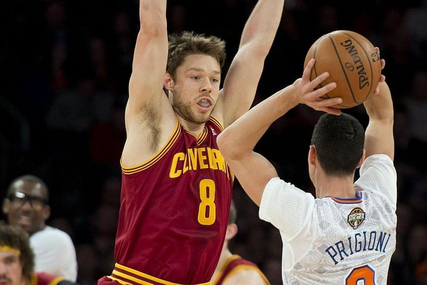 Cleveland Cavaliers Matthew Dellavedova (8) covers New York Knicks Pablo Prigioni during their NBA game March 23, 2014 at Madison Square Garden in New York. Jarrett Jack finished with a season-high 31 points and tallied 10 assists to lead the Clevela