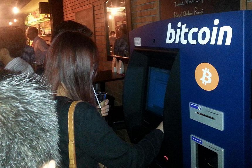 Singapore's first machine that can accept bitcoins and return cash opened at Bartini Kitchen in Boon Tat Street on Monday, March 24, 2014.-- PHOTO: DAVID MOSKOWITZ/COIN REPUBLIC