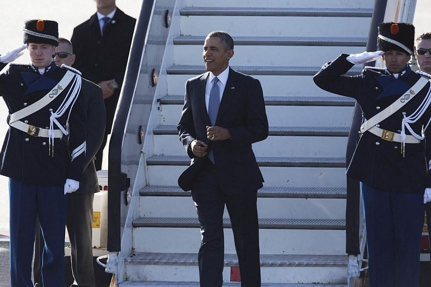 US president Barack Obama (centre) disembarks from Air Force One upon his arrival at Schiphol Amsterdam Airport on March 24, 2014 to attend the two-day Nuclear Security Summit (NSS) in The Hague. US President Barack Obama arrived in the Netherla