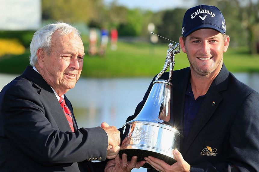 Arnold Palmer congratulates Matt Every of the United States as he celebrates with the trophy after winning the Arnold Palmer Invitational presented by MasterCard at the Bay Hill Club and Lodge on March 23, 2014 in Orlando, Florida. -- PHOTO: AFP
