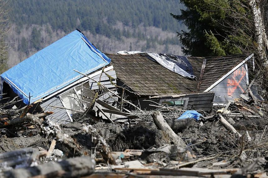 A landslide and structural debris blocks Highway 530 near Oso, Washington, on March 23, 2014. -- PHOTO: REUTERS