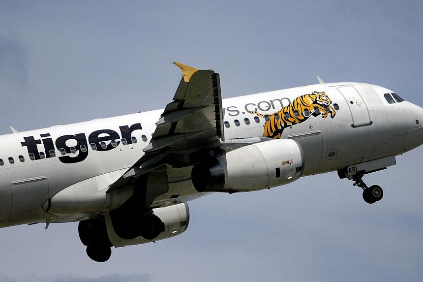 Singapore's Tiger Airways Holdings has placed an order for 37 Airbus A320neo aircraft valued at US$3.8 billion (S$4.8 billion) at list prices. -- FILE PHOTO: BLOOMBERG