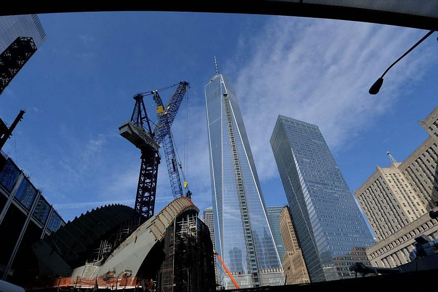 Four men accused of organising a parachute jump from the top of the 104-story One World Trade Center (centre) in New York City in September were arrested after turning themselves in. -- FILE PHOTO: AFP
