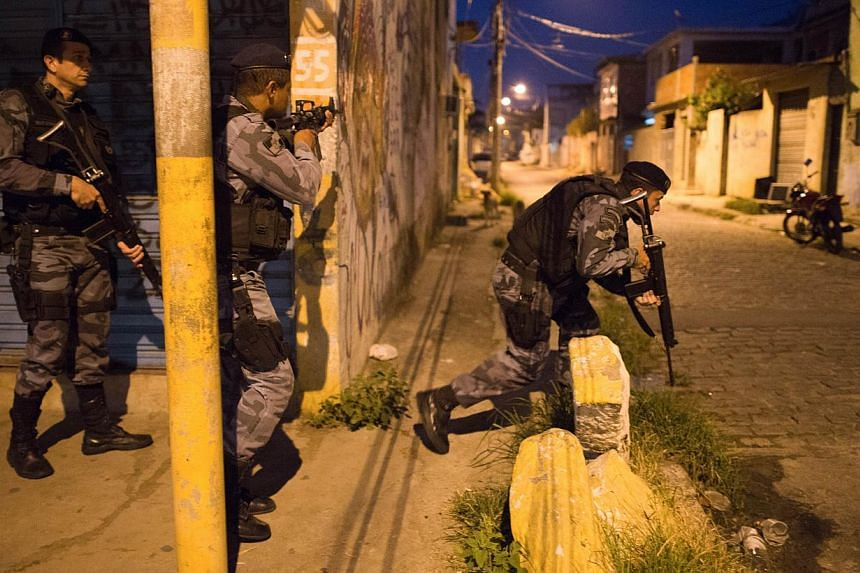 Paramilitary police during an operation in the Vila Kennedy shantytown in Rio de Janeiro, Brazil on March 13 , 2014. -- FILE PHOTO: AFP