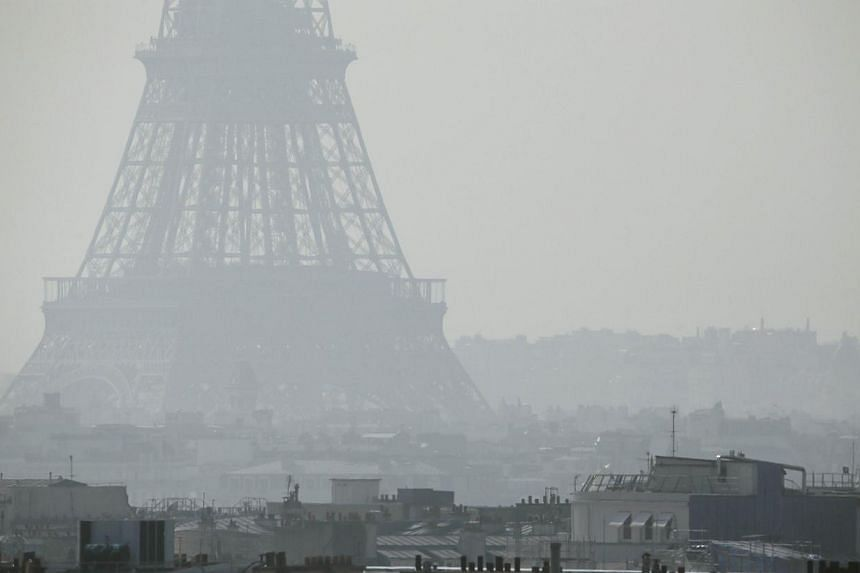 A view of the Eiffel Tower seen through thick smog, on March 14, 2014, in Paris.Air pollution by sources ranging from cooking fires to auto fumes contributed to an estimated seven million deaths worldwide in 2012, the UN health agency said Tues