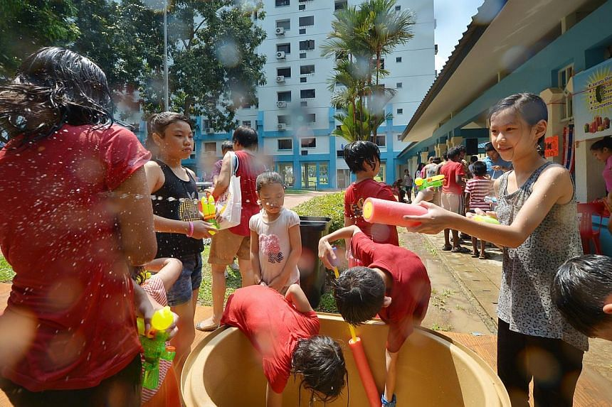 Children soaking one another with water guns at a Songkran event in Sembawang last year. This year's festival at the Padang will not feature any water-related activities. Instead, there will be a bazaar, carnival, muay thai tournament, music festival