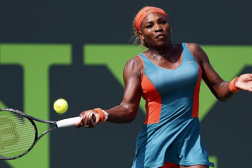 Serena Williams hitting a forehand against Coco Vandeweghe on day eight of the Sony Open at the Crandon Tennis Centre in Miami on Monday, March 24, 2014. - PHOTO: REUTERS