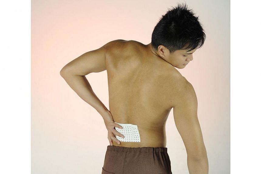 Nearly a tenth - 9.4 per cent - of the world's population has lower back pain, and the ailment also accounts for a third of all work-related disability. -- ST FILE PHOTO: ASHLEIGH SIM