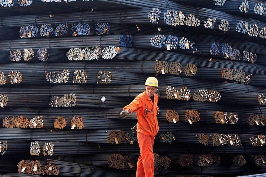 Steel rods in a steel market in Qingdao, Shandong province. The Ministry of Industry and Information Technology said China would continue to simplify approval procedures and also make it easier for firms in bloated sectors like steel, cement and alum