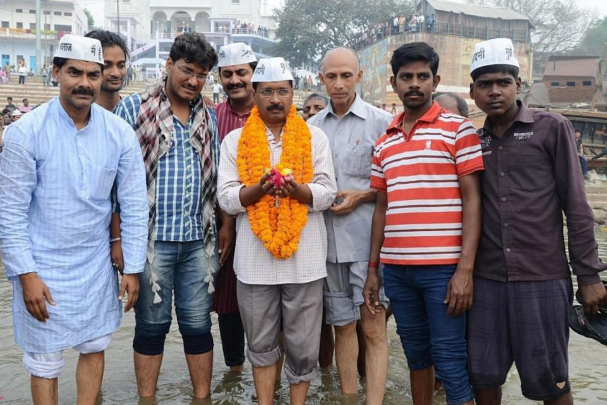 Indian head of the Aam Aadmi (Common Man) Party Arvind Kejriwal (centre) poses for a photograph as he visits the river Ganges in Varanasi on March 25, 2014. The leader of a fledgling Indian anti-corruption party was expected to announce plans on Tues