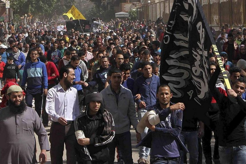 Supporters of the Muslim Brotherhood and Islamist President Mohamed Mursi, who was overthrown by the army after demonstrations against his rule last July, shout slogans during a protest in Matarya area, east of Cairo, on March 21, 2014. Around 700 su