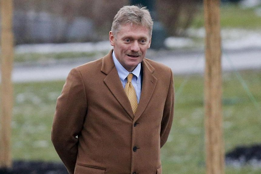 Russia's President Vladimir Putin's spokesman Dmitry Peskov walks before a wreath laying ceremony to mark the Defender of the Fatherland Day at the Tomb of the Unknown Soldier by the Kremlin walls in central Moscow February 23, 2014. Russia on Tuesda