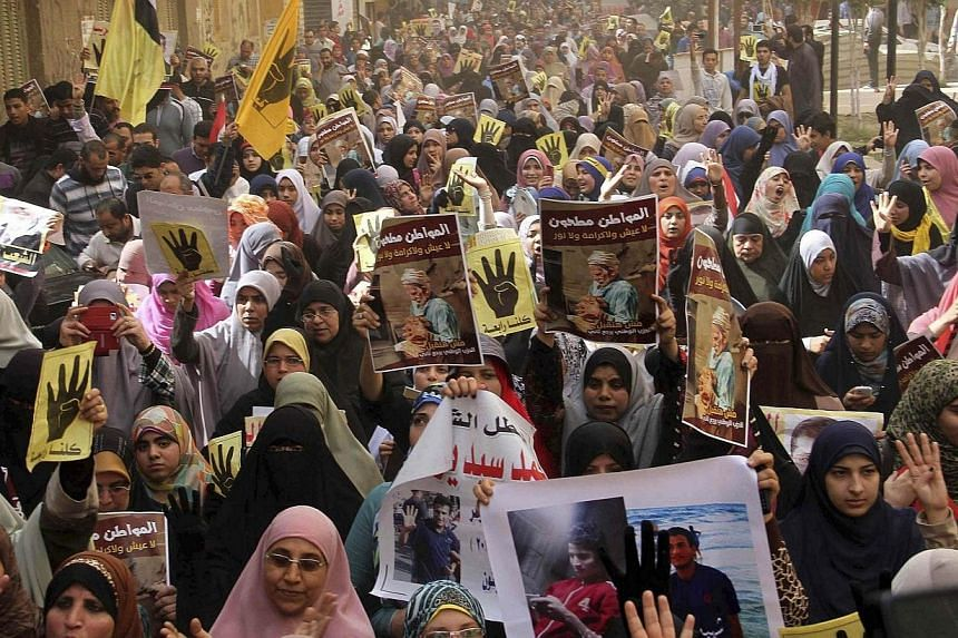 Supporters of Islamist President Mohamed Mursi, who was overthrown by the army after demonstrations against his rule last July, shout slogans during a protest in Matariya area, east of Cairo, March 7, 2014. An Egypt court that triggered a global outc