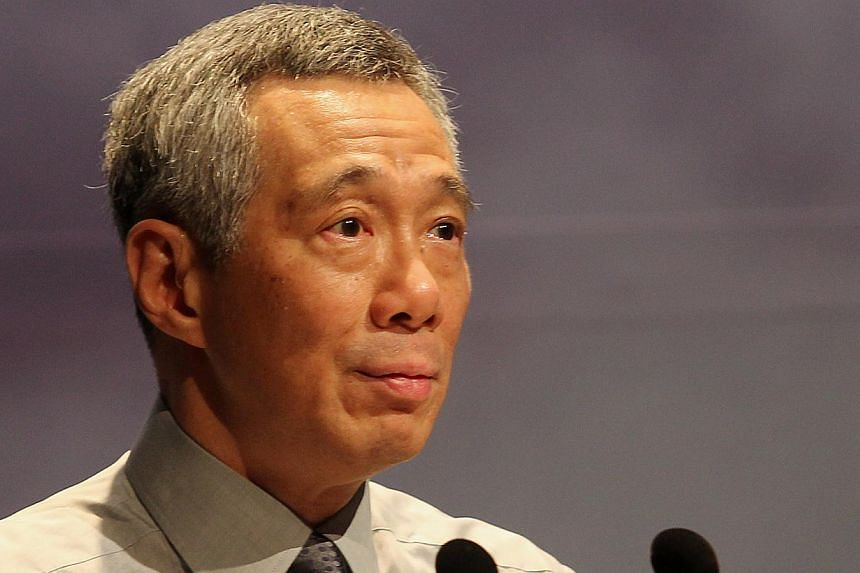 """Prime Minister Lee Hsien Loong, who was the first Singapore leader to express his sympathies on Monday night, also said he was """"deeply saddened to hear about the tragic fate of MH370"""".-- BH FILE PHOTO: TUKIMAN WARJI"""