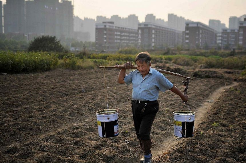 Premature deaths and health problems from air pollution cost China as much as US$300 billion (S$381.6 billion) a year, an official report said on Tuesday, March 25, 2014, calling for a new urbanisation model for the world's second-largest economy. --