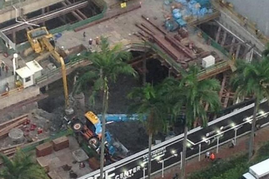 A piece of heavy construction machinery toppled over at a worksite in Tanjong Pagar on Tuesday evening, March 25, 2014.-- PHOTO: KERRY DEVLIN
