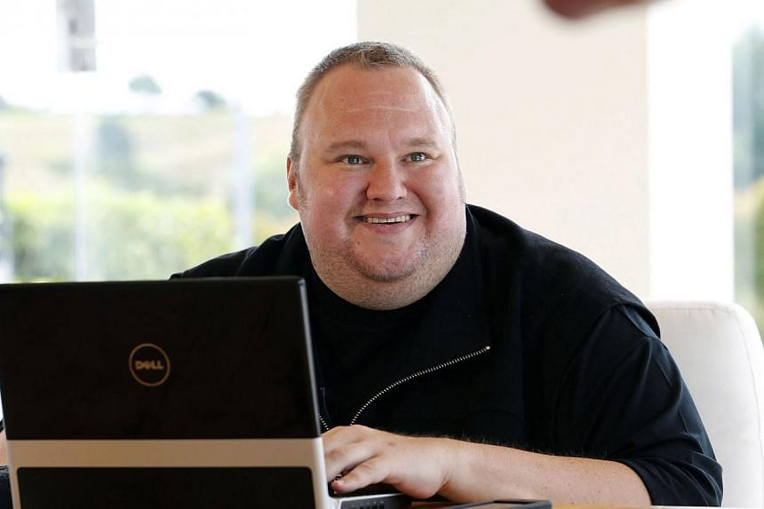 """Internet mogul Kim Dotcom, who is fighting US extradition for online piracy, is seeking a """"backdoor listing"""" of his data storage firm on New Zealand's stock market, in a deal that values it at NZ$210 million (S$228 million). -- PHOTO: REUTERS"""