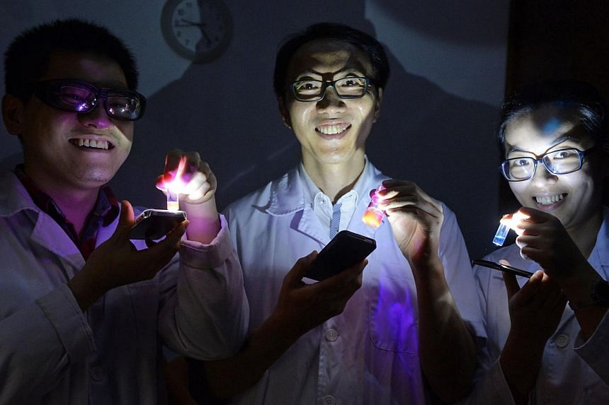 (From left) Xu Wang, 26, Prof. Chang Young-Tae, in his 40's, and Dr Zhai Daunting, in her 20's, NUS researchers who developed a flourescent sensor for detecting date rape drug GHB in drinks, pictured on March 25, 2014. A new sensor which can tel
