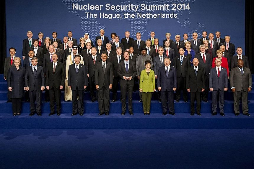 US President Barack Obama (front centre-left) and Dutch Prime Minister Mark Rutte (centre-right) pose for a family picture with other world leaders, ministers and heads of international organisations on the second day of the two-day Nuclear Security
