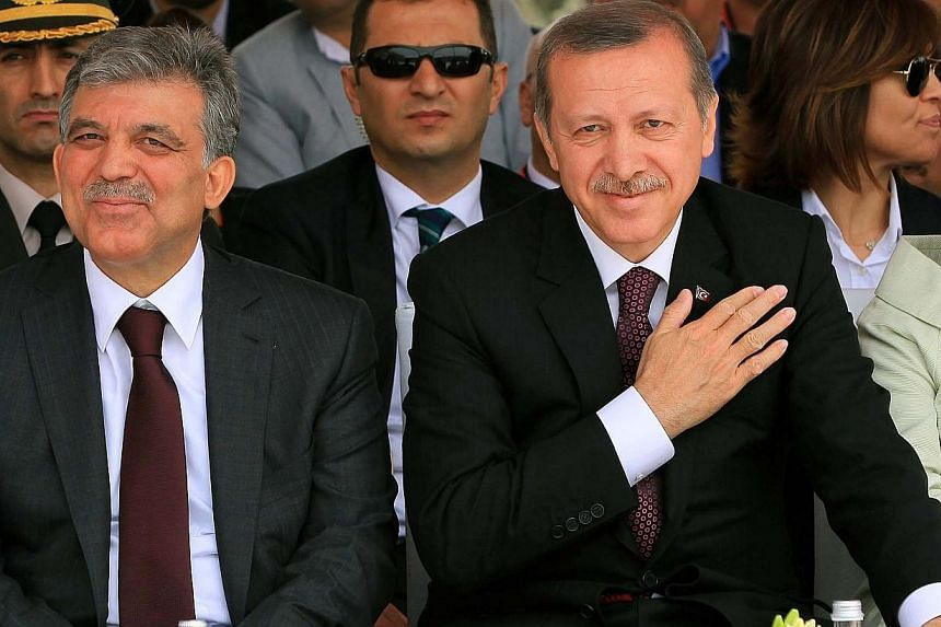 This file picture dated on May 29, 2013, shows Turkish Prime Minister Recep Tayyip Erdogan (right) and Turkish president Abdullah Gul (left) attending the opening ceremony of the third Bosphorus bridge in Istanbul. It was arguably the strong partners