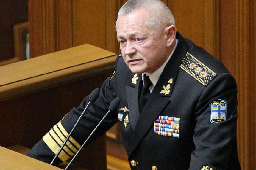 Former Ukrainian Defence Minister Igor Tenyukh delivers a speech during a parliament session in Kiev on March 25, 2014.Ukraine's parliament sacked the crisis-hit country's besieged defence minister Tuesday, March 25, 2014, after his forces bega