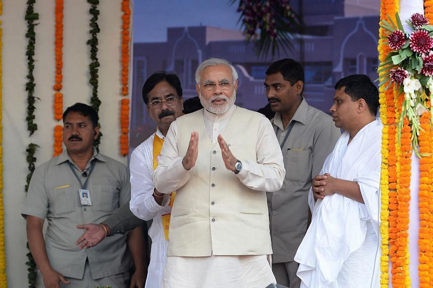 Mr Modi, 63, chief minister of Gujarat, was placed on a visa blacklist by the US and European governments following communal riots on his patch in 2002. -- FILE PHOTO: AFP