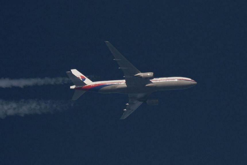 Boeing 777 Malaysian Airlines with the registration number 9M-MRO flies over Poland on Feb 5, 2014. The United States aviation regulator on Tuesday, March 25, 2014, ordered a immediate fix for a software glitch affecting thrust reversers on some