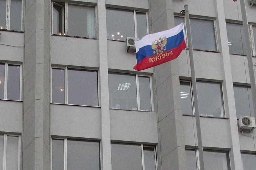 A Russian flag is seen flying outside the State and City administration building in the Crimean city of Sevastopol on Feb 24, 2014.One of Russia's most prestigious universities faced accusations Tuesday, March 25, 2014, of political censorship