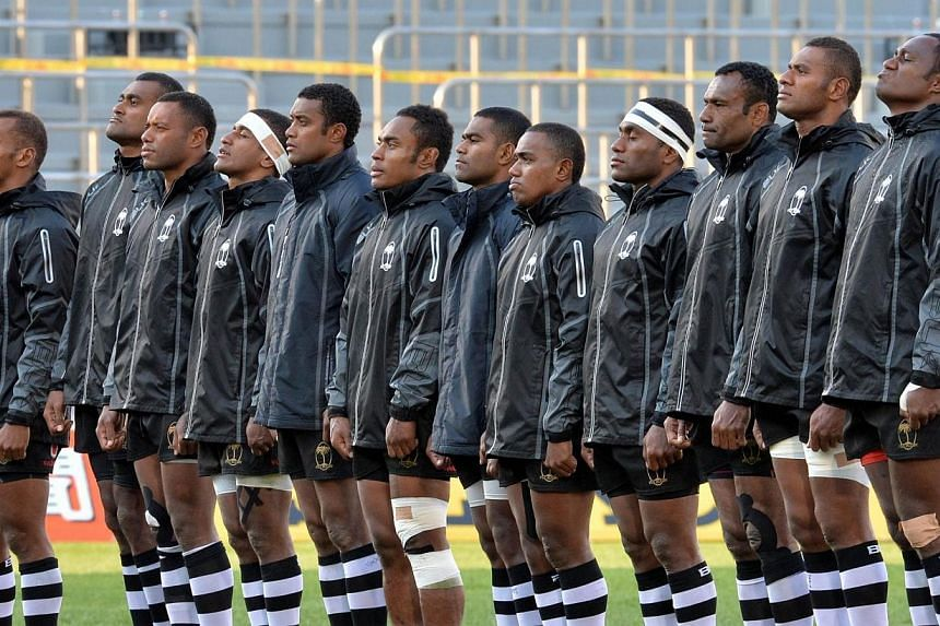 Fiji players sing the country's national anthem prior to their Tokyo Sevens 2014 Cup final match against South Africa, part of the Rugby Sevens World Series, in Tokyo on March 23, 2014.Fiji is threatening to boycott this year's Glasgow Commonwe