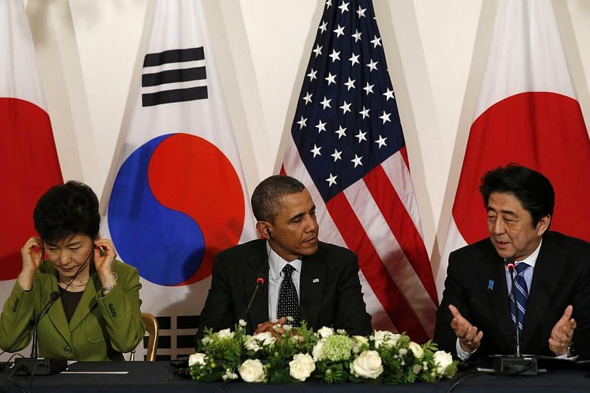 US President Barack Obama holds a tri-lateral meeting with President Park Geun-hye of the South Korea (L) and Prime Minister Shinzo Abe of Japan (R) after the Nuclear Security Summit in The Hague March 25, 2014.-- PHOTO: REUTERS