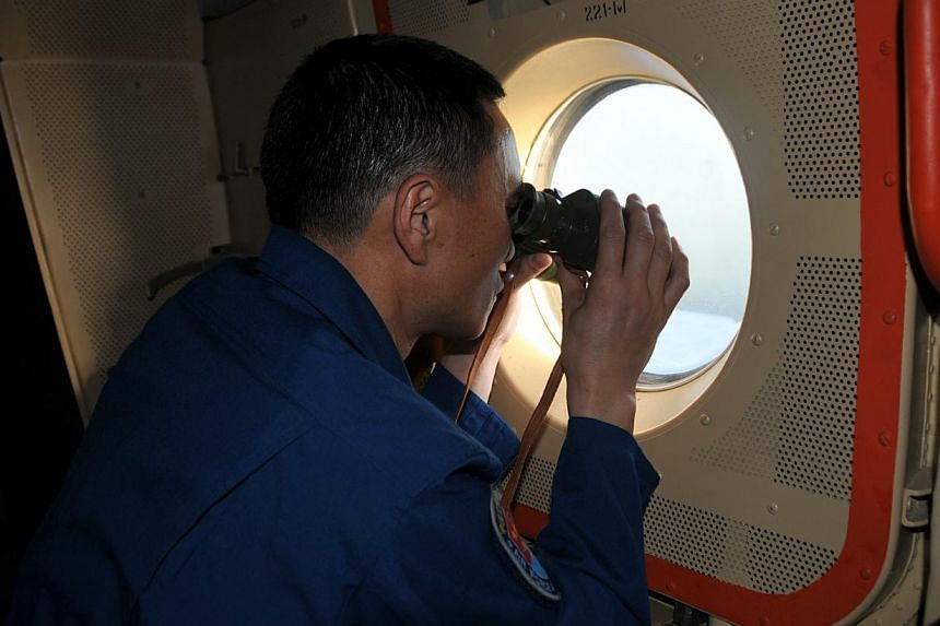A Chinese air force crew member looking for signs of the missing Flight MH370 in the southern Indian Ocean. Since the aircraft's disappearance, Beijing's actions not only revealed its readiness - or lack of it - for handling such an emergency, but al