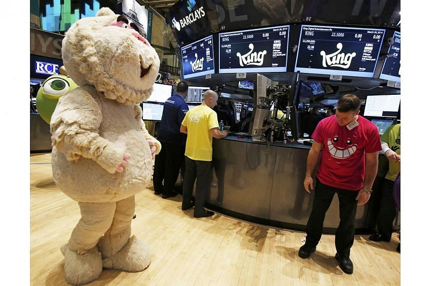 "A mascot dressed as a character from the mobile game ""Candy Crush Saga"" walks the floor of the New York Stock Exchange during the IPO of Mobile game maker King Digital Entertainment Plc March 26, 2014. King Digital, the maker of the wildly popular vi"