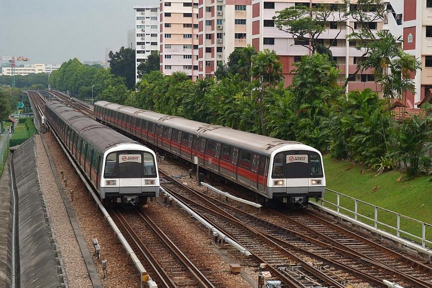 Two MRT trains travelling on the tracks along Ang Mo Kio Avenue 8. SMRT will stop train services at six North-South Line stations 30 minutes earlier from April for five nights a week, to speed up track replacement works.-- ST FILE PHOTO: ALPHON