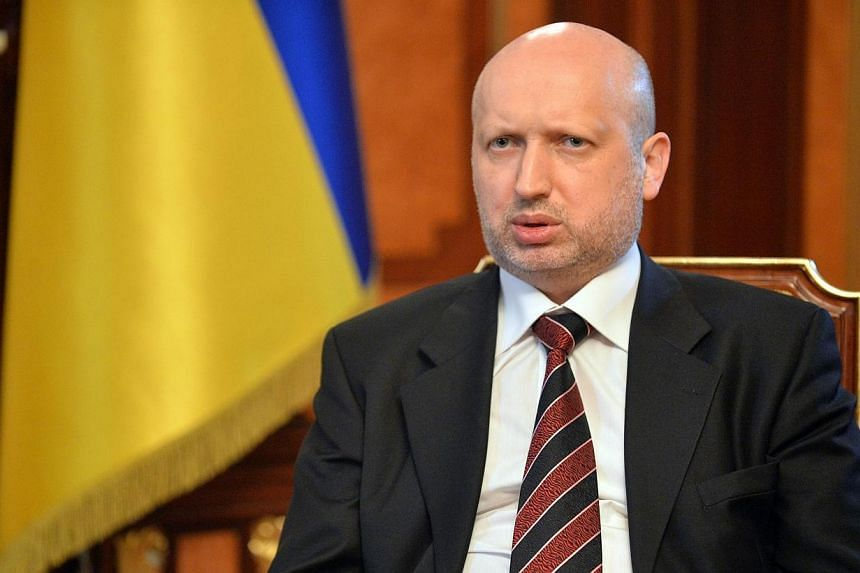Olexander Turchynov, speaker of the Ukrainian parliament and interim Ukrainian president (centre) answers questions during an exlusive interview in Kiev on March 11, 2014. Ukraine's acting president asked parliamentary approval on Wednesday for a set