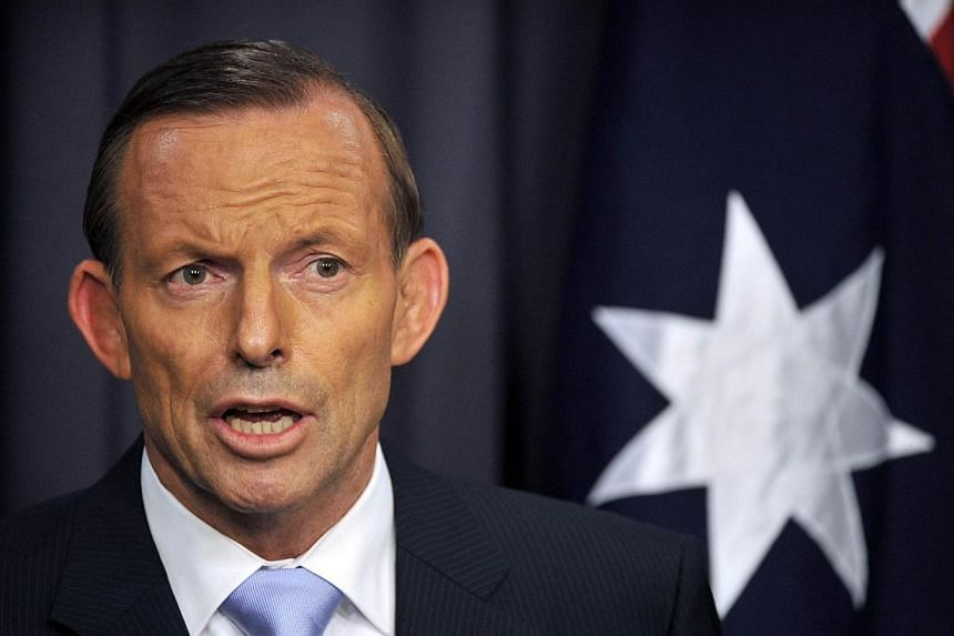 Australia's Prime Minister Tony Abbott speaks to the media at Parliament House in the capital Canberra on March 25, 2014. The conservative government of Prime Minister Tony Abbott on Wednesday, March 26, 2014 said it would press ahead with the sale o