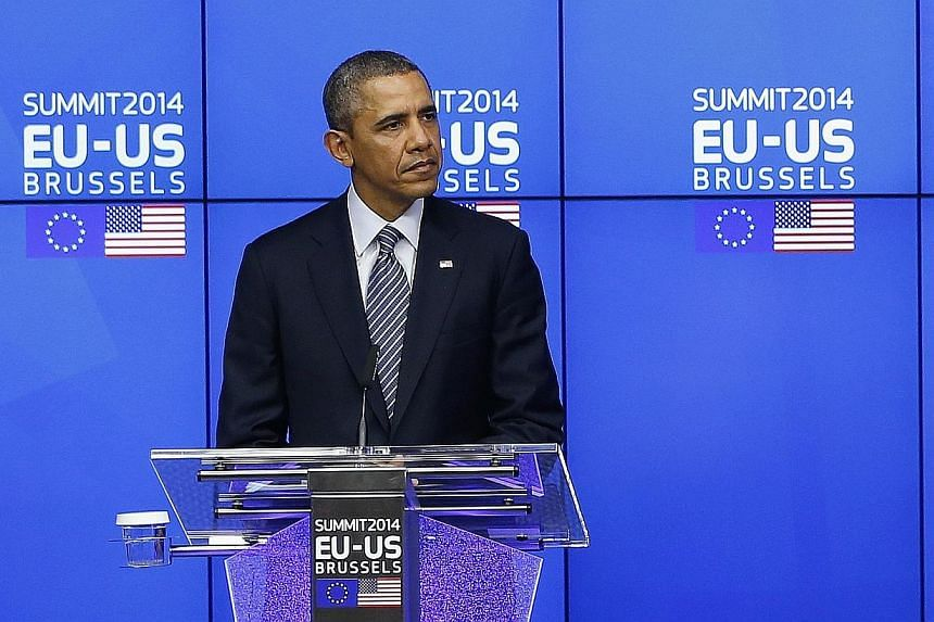 """US President Barack Obama takes part in a EU-US summit in Brussels on March 26, 2014.President Obama said at the close of an EU-US summit in Brussels on Wednesday, March 26, 2014, that the world was a safer place """"when Europe and America stand"""