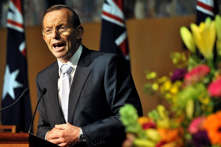 "Australian Prime Minister Tony Abbott was accused on Wednesday of sending the country into a ""time warp"" by reintroducing knights and dames to Australia's honours list. -- PHOTO: AFP"