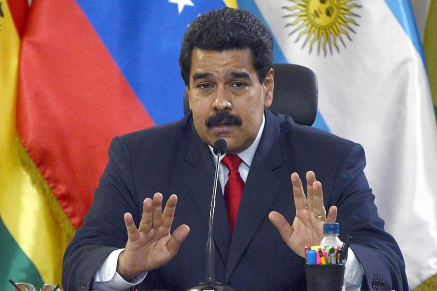 Venezuelan President Nicolas Maduro speaking at the UNASUR's foreign ministers meeting at the Miraflores Presidential Palace in Caracas on March 25, 2014. -- PHOTO: AFP