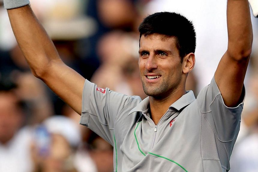 Novak Djokovic of Serbia celebrates his win over Andy Murray of Great Britain during the Sony Open at the Crandon Park Tennis Center on March 26, 2014 in Key Biscayne, Florida. -- PHOTO: AFP